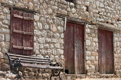 Greek traditional house and bench Royalty Free Stock Photos