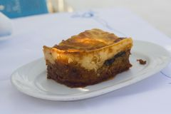Greek traditional moussaka on a white plate royalty free stock image