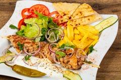 Greek traditional souvlaki. With vegetables stock photos