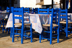 In a greek traditional tavern. Table with blue traditional greek chairs Royalty Free Stock Image