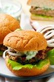 Greek turkey burgers tzatziki sauce. Selective focus Royalty Free Stock Image