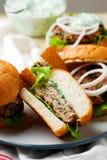 Greek turkey burgers tzatziki sauce. Selective focus Stock Photography