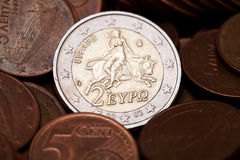 Greek two euros coin among  coins of five cents. Representing the abduction of Europe (from Greek Mythology Royalty Free Stock Image