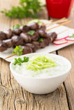 Greek Tzatziki dip with chicken heart kebabs Stock Photo