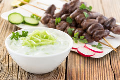 Greek Tzatziki dip with chicken heart kebabs Stock Images
