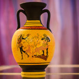 Greek vase. Greek yellow vase on purple/white background Stock Photo