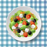 Greek vegetable salad with fresh tasty tomatoes, feta cheese, bl Royalty Free Stock Image