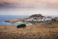 Greek village Lindos in Rhodes. Village Lindos in Rhodes with white houses in bay on ocean in Greece Royalty Free Stock Photos