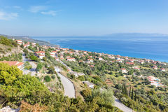 Greek village near sea in Kefalonia. Greek village near blue sea in Kefalonia Greece on Sunny day Stock Image