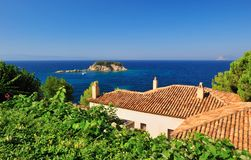 Greek village rooftops overlooking the Aegean Royalty Free Stock Images
