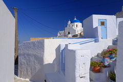 Greek village. Typical Greek village with whitewashed walls,  pale blue doors, gate and orthodox church dome Royalty Free Stock Photos