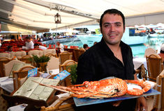Greek Waiter With Lobster Stock Photography