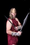 Greek warrior. One adult male greek warrior with swords over black Royalty Free Stock Photos