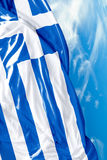 Greek waving flag on a beautiful day Stock Image