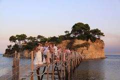 Greek wedding on the bridge to Cameo Island, zakynthos, greece. Greek wedding in progress on a wooden bridge to the island of Cameo in the mediterranean sea near royalty free stock images