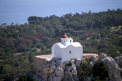 Greek white chapel on a hill Stock Photography