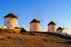 Greek windmills. Famous row of traditional Greek windmills at sunset, Mykonos, Greece Stock Photos