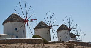 Greek Windmills at Mykanos. Characteristic Greek Windmills along the coast at Mykanos Royalty Free Stock Photography