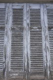Greek window louver shutters with peeling paint Stock Image