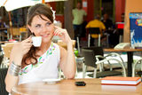 Greek woman in cafe Stock Images