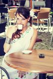 Greek woman in the cafe Stock Photos