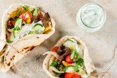 Greek wrapped sandwich gyros stock photos