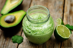 Greek yogurt avocado cilantro lime dressing. Toning. selective focus stock photos