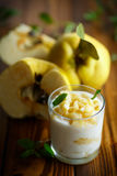 Greek yogurt with baked quince Stock Images
