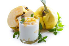 Greek yogurt with baked quince Royalty Free Stock Photo