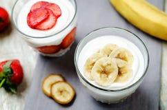 Greek yogurt banana parfaits. On a wood background. toning. selective focus royalty free stock photos