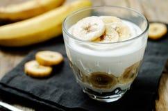 Greek yogurt banana parfaits. On a wood background. toning. selective focus stock image