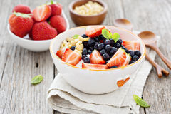 Greek yogurt bowl with fresh berries and nuts. Greek yogurt bowl with fresh berries and pine nuts Royalty Free Stock Photo