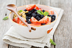 Greek yogurt bowl with fresh berries and nuts Stock Photography