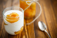Greek yogurt with canned apricots in a glass Stock Photo