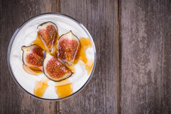 Greek yogurt with figs and honey Stock Photo