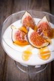 Greek yogurt with figs and honey stock photos