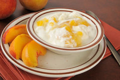 Greek yogurt with fresh peaches Stock Photos