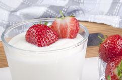 Greek yogurt and fresh strawberries Stock Photo