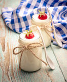 Greek yogurt glass, with strawberries, vertical Stock Photography
