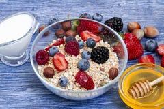 Greek yogurt granola and berry mix. Top view. Delicious healthy muesli with raspberry, blueberry, strawberry, hazelnut stock photography