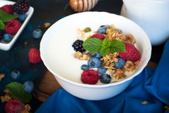 Greek yogurt with granola and fresh berries. Healthy breakfast. Greek yogurt with granola and fresh berries Royalty Free Stock Images