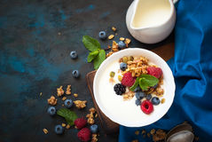 Greek yogurt with granola and fresh berries. Healthy breakfast. Greek yogurt with granola and fresh berries. Top view with copy space Royalty Free Stock Photos
