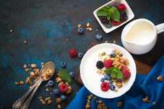 Greek yogurt with granola and fresh berries. Healthy breakfast. Greek yogurt with granola and fresh berries. Top view with copy space Royalty Free Stock Image