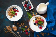 Greek yogurt with granola and fresh berries. Healthy breakfast. Greek yogurt with granola and fresh berries. Top view with copy space Stock Photo