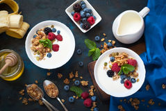 Greek yogurt with granola and fresh berries. Healthy breakfast. Greek yogurt with granola and fresh berries. Top view with copy space Stock Images