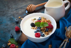 Greek yogurt with granola and fresh berries. Royalty Free Stock Images