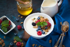 Greek yogurt with granola and fresh berries. Healthy breakfast. Greek yogurt with granola and fresh berries. Top view with copy space Royalty Free Stock Photography