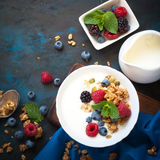 Greek yogurt with granola and fresh berries. Healthy breakfast. Greek yogurt with granola and fresh berries. Top view with copy space Stock Photography