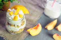 Greek yogurt with granola and peach Royalty Free Stock Photo