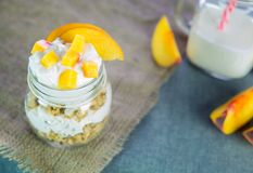 Greek yogurt with granola and peach Stock Photo